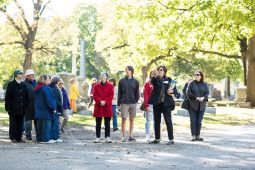 Tour participants wander through the cemetery. | MAX HERMAN/Contributor
