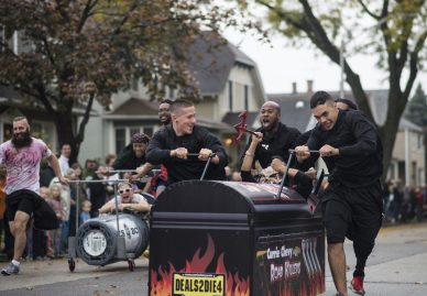 Chevy Currie Motors team celebrates winning their heat during the annual Casket Race in Forest Park on Saturday, Oct. 24. | William Camargo/Staff Photographer
