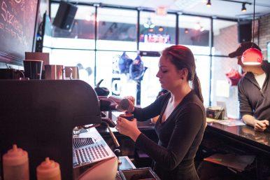 Ellie Porreta prepares a drink for a customer. | William Camargo/Staff Photographer