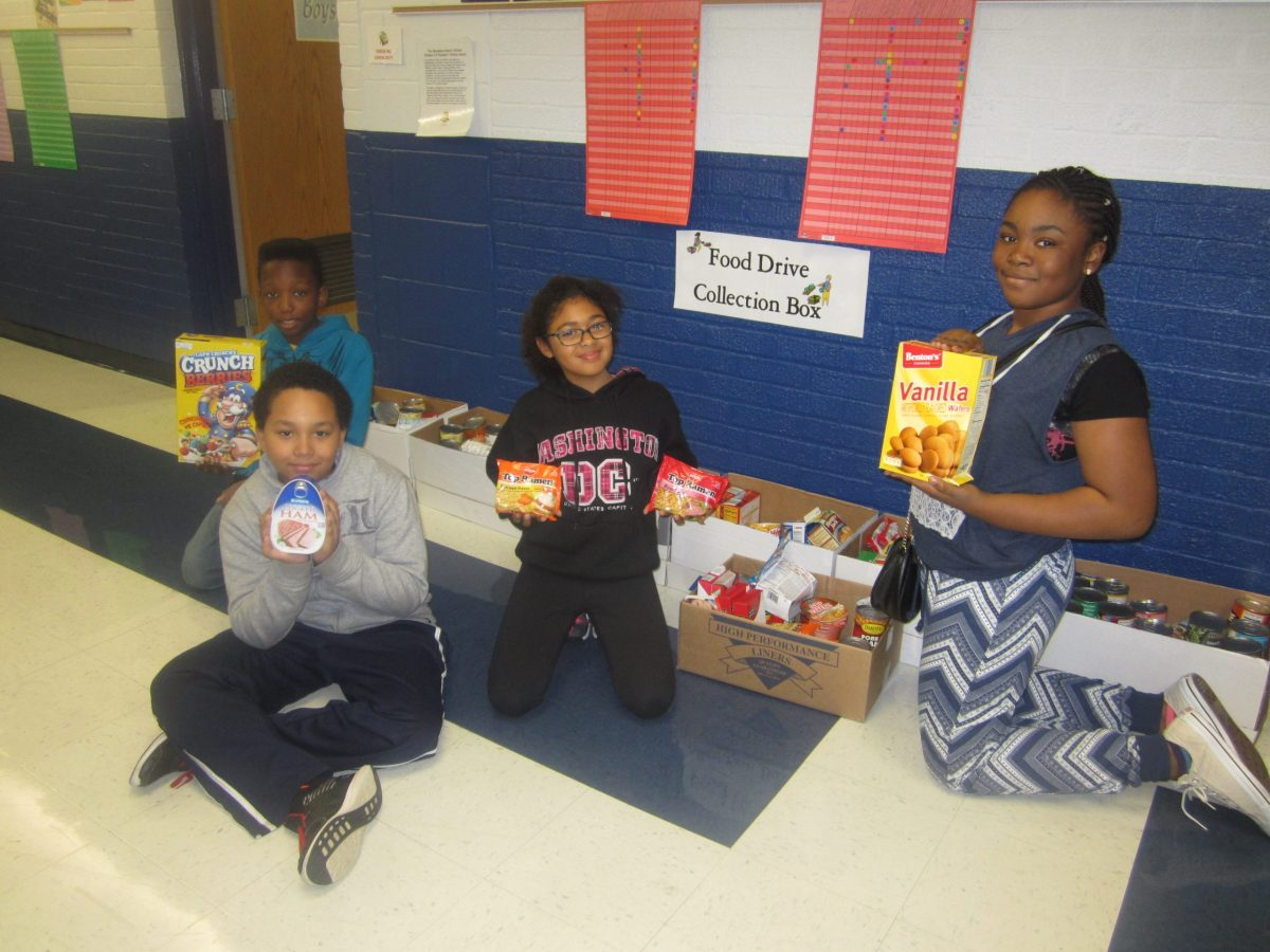 NEHS students with some boxes of food