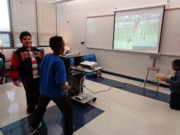 Students playing a game of Wii.