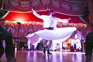 Dervish Azaz performs a Sufi sacred dance during a concert at Pineapple Dance Studios on Jan. 23. | File photo
