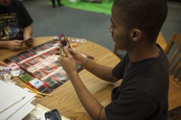 Trevon Sanders plays a Yu-Gi-Oh! match against Trevor Brown. | William Camargo/Staff Photographer