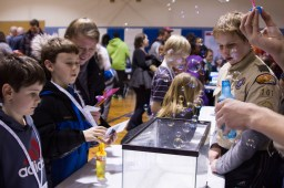 Brandon Arnold, left, a third-grader at Field-Stevenson Elementary School, watches a demonstration involving baking soda, vinegar, and bubbles during Science Night on February 19. | Stacey Rupolo/Contributor
