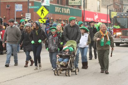 Everyone gets involved, including Mayor Tony Calderone, (above, right) carrying his shillelagh during the 2013 parade. | File photos