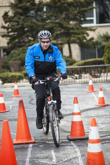 Officer Spagnulo goes through a bike course to demonstrate bike safety. | William Camargo/Staff Photographer