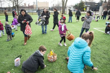 Kids hunt for eggs of the plastic and chocolate variety in The Park during the annual Egg Hunt in Forest Park on March 19. | William Camargo/Staff Photographer