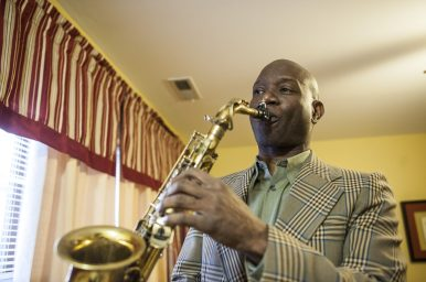 Audley Reid plays his saxophone at home. He says a lot of musicians call Forest Park home. | William Camargo/Staff Photographer