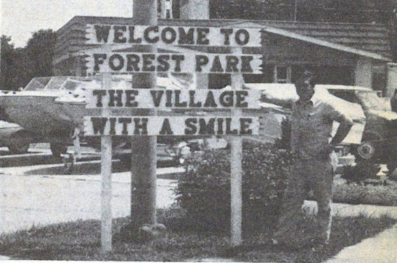 Don Hinz standing next to his 1975 welcome sign at Des Plaines and Eisenhower.