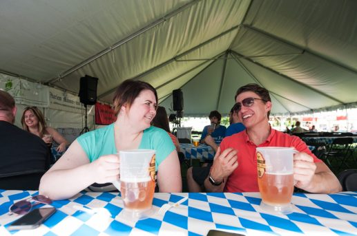 Kat Rybarski and Michael Bradt of the Bad Improv Gun enjoy beers while warming up for their performance at German Fest on June 11. | MAX HERMAN/Contributor