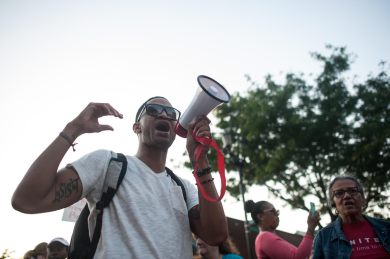 Anthony Clark, an Oak Park and River Forest High School special education teacher, during a July 16 protest march from OPRF to Madison St. in Forest Park. Clark said the march was his response to the racism and discrimination he's experienced living in Oak Park and surrounding suburbs. | William Camargo/Staff