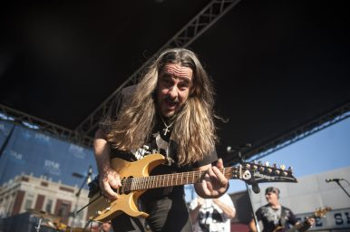 Dave Uhrich of 97 Nine plays on the East Stage in downtown Forest Park during Music Fest last Saturday.   William Camargo/Staff Photographer