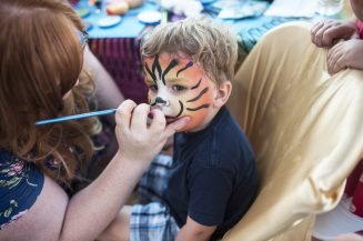 Max Andexler gets his face painted as a tiger.   William Camargo/Staff Photographer