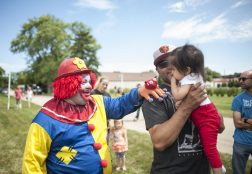Koopy the clown plays with Gianna Torres. | William Camargo/Staff Photographer
