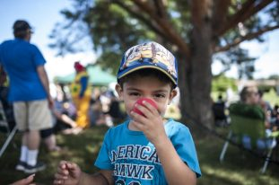 Giovani Melgoza tries on a red nose. | William Camargo/Staff Photographer