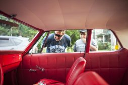 Tim Gurtner and his son, Danny, gaze upon a classic Plymouth. | William Camargo/Staff Photographer