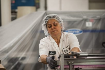 Elva Raygoza prepared boxes for the candy. | William Camargo/Staff Photographer