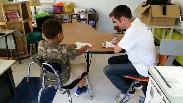 Mr. McElligott conducting a fluency interview with a student at Grant-White