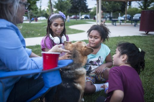 Emily Martinez, Maya Mulillo and Elizabeth Lopez play with Ringo the dog. | William Camargo/Staff Photographer
