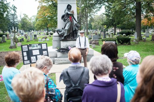 Tyler Watkins, addresses attendees at the Tales of the Tombstones walk, Sunday, which was sponsored by the Historical Society. | William Camargo/Staff Photographer
