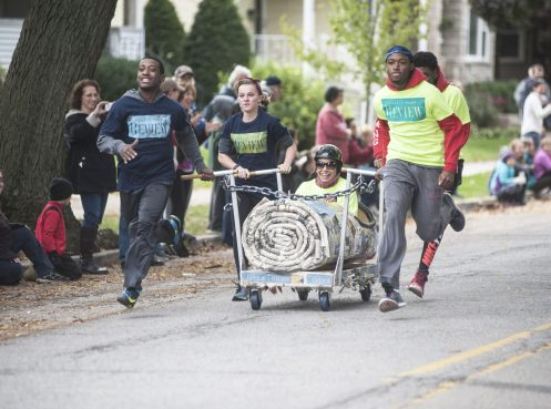 The Forest Park Review casket, designed as a rolled-up newspaper, came out of nowhere to claim the championship in the annual Casket Race in Forest Park last Saturday. | Joseph Chomiczewski/Staff