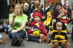 Children and parents join Halloween storytime at the library Friday. | William Camargo/Staff Photographer