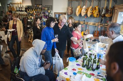 A group of wine lovers at a local shop take part in this year's Wine Walk/Shop event in downtown Forest Park on Nov. 3. | William Camargo/Staff Photographer