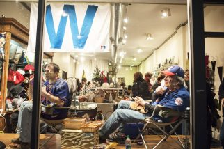 Cubs fans watch the historic game 7 at Camille et Famille. | William Camargo/Staff Photographer
