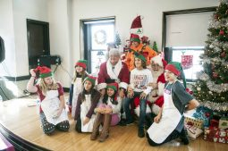 Santa's elves gave out treats to children.   William Camargo/Staff Photographer