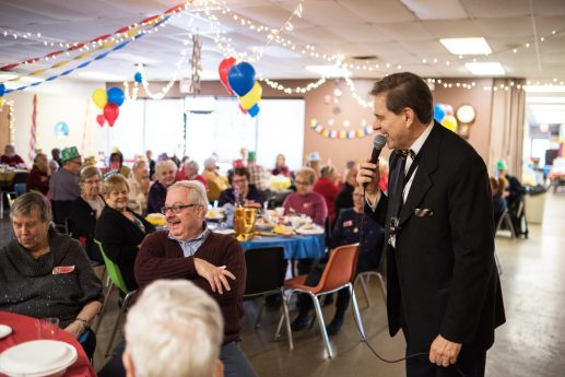 Ken Wojcik jokes with party-goers at the senior New Year's Eve party at the Howard Mohr Community Center on Dec. 31. | MAX HERMAN/Contributor
