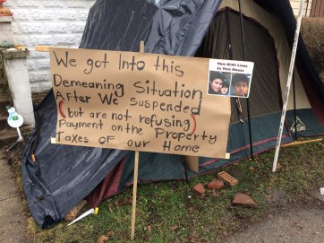 One of the signs outside the tent.