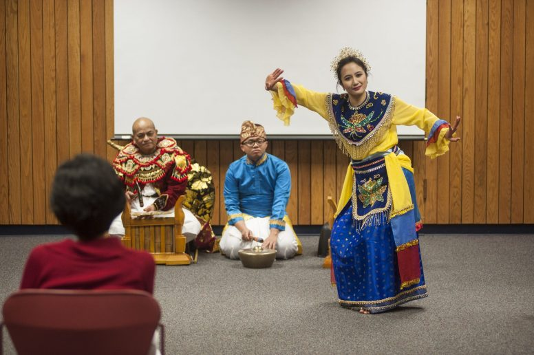 Tagung Chika Kertayudo shows people at the Forest Park Public Library a traditional dance during a Sunday presentation on Indonesian culture on Jan. 8. | William Camargo/Staff Photographer