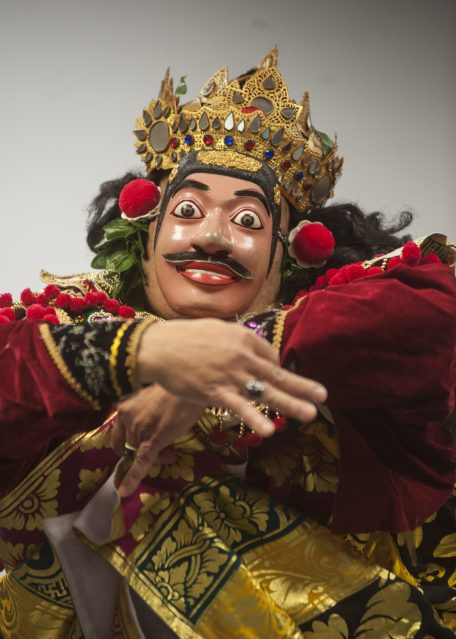 Gusti Ngurah Kertayuda, director of Indonesian Dance of Illinois, demonstrates a traditional Indonesian dance wearing a mask. | William Camargo/Staff Photographer