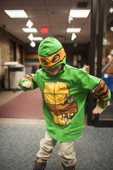 Giovanni Brezwin, dressed as a ninja turtle, busts a move. | William Camargo/Staff Photographer