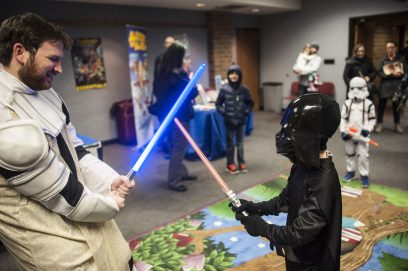Darth Vader fights a Jedi in a re-enactment of Star Wars during Flip-Con at the Forest Park Public Library on Jan. 14. | William Camargo/Staff Photographer