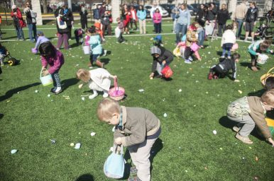 Kids keep their eyes on the prizes during the Easter Egg Hunt in Forest Park. | William Camargo/Staff Photographer