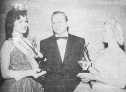 Blanche Kos accepted her trophy after being named Miss Proviso 1957. Josh Brady, a popular Chicago radio personality, and Gerry Lange, Miss Proviso 1956, made the presentation. | Photo courtesy Forest Park Historical Society