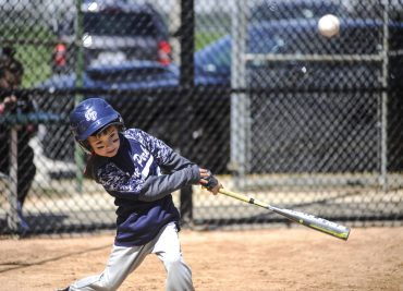 Nolan Novak hits a fly ball during the opening game of Forest Park Little League on Saturday. | William Camargo/Staff Photographer