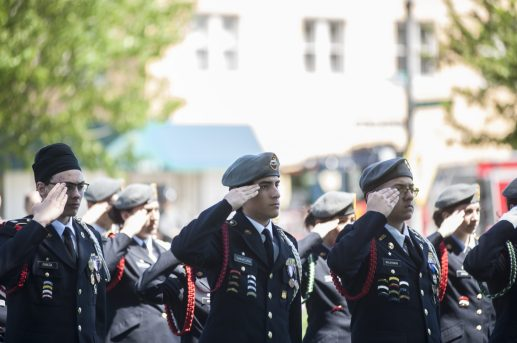 JROTC Cadets salute during the shots fired to commemorate fallen soldiers. | William Camargo/Staff Photographer