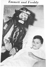 Emmett Kelly cheered up Forest Parker Freddy Hereau at MacNeal Hospital.   Photo courtesy Forest Park Historical Society