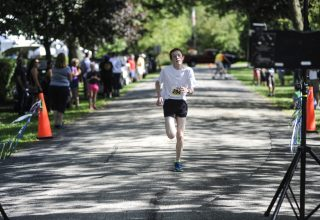 Peter Halloran finished first in 17 minutes and 20 seconds. | William Camargo/Staff Photographer