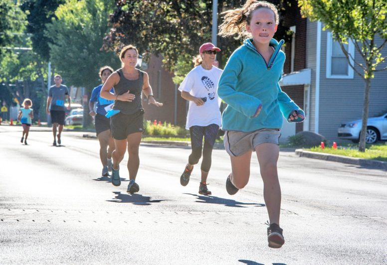 Participants compete on Saturday, Aug. 12, during the 2nd annual Back to School 5K near Forest Park Middle School in Forest Park.   Alexa Rogals/Staff Photographer