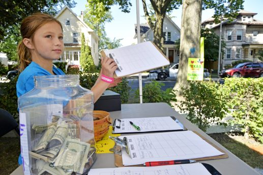 Storey Novak, 10, of Forest Park, receives donations from people throughout the community on Sept. 2, at the Novak's home on Hannah Avenue in Forest Park.   Alexa Rogals/Staff Photographer