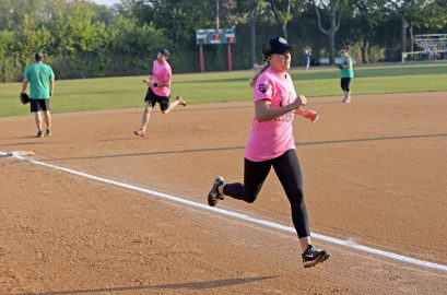 Pitches Be Crazy players round the bases and gain two runs. | Alexa Rogals/Staff Photographer