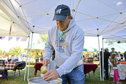Dan Kunkel, of Wheaton, pours a sample for attendees. | Alexa Rogals/Staff Photographer