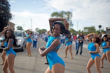 The Proviso East High School color guard performs during the Proviso East Homecoming Parade in Maywood last Saturday. | Alexa Rogals/Staff Photographer
