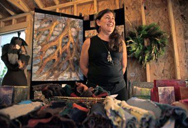 Artist Pamela Penney, of Oak Park, stands near her pieces to sell. | Alexa Rogals/Staff Photographer