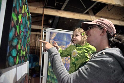Eve Barrs and her daughter Robin, 2, check out artwork in one of the garages on Saturday, Oct. 7, during the annual GarageGalleries event at various locations in Forest Park. | Alexa Rogals/Staff Photographer