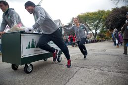The Forest Park National Bank & Trust Co. team race their casket on Saturday, Oct. 28, 2017, during the 6th annual Forest Park Chamber of Commerce Casket Races on Beloit Avenue, south of Madison Street in Forest Park, Ill. (ALEXA ROGALS/Staff Photographer)