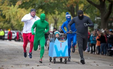 The Park District of Forest Park team races down the road on Saturday, Oct. 28, 2017, during the 6th annual Forest Park Chamber of Commerce Casket Races on Beloit Avenue, south of Madison Street in Forest Park, Ill. (ALEXA ROGALS/Staff Photographer)